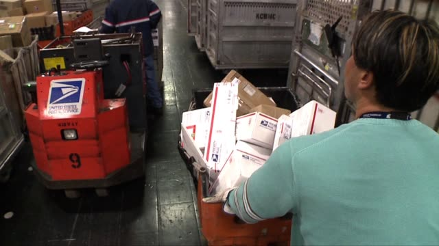 people at a post office in san diego on august 13, 2013 in san diego, california - post office stock videos & royalty-free footage