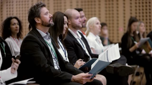 people at a seminar listening to the speakers and making notes - business conference stock videos & royalty-free footage