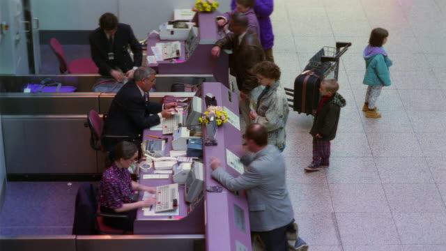 T/L, HA, MS, People at airport check-in counter, England