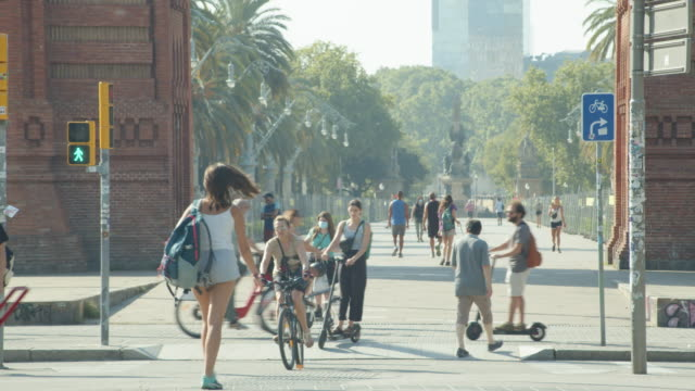 people at barcelona during covid-19 crisis. arc de triomf - triumphal arch stock videos & royalty-free footage