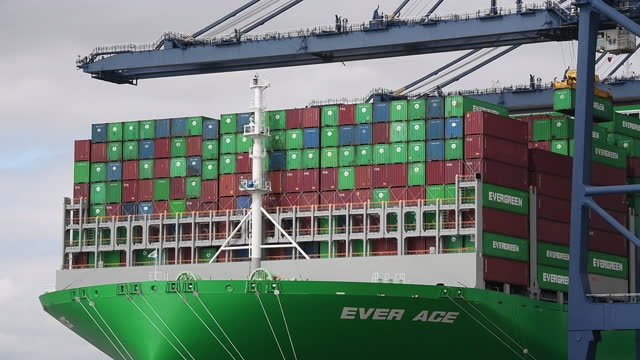 people at beach and port of felixstowe, with world's largest container ship, ever ace, being loaded and leaving, in felixstowe, suffolk, england,... - western script stock videos & royalty-free footage