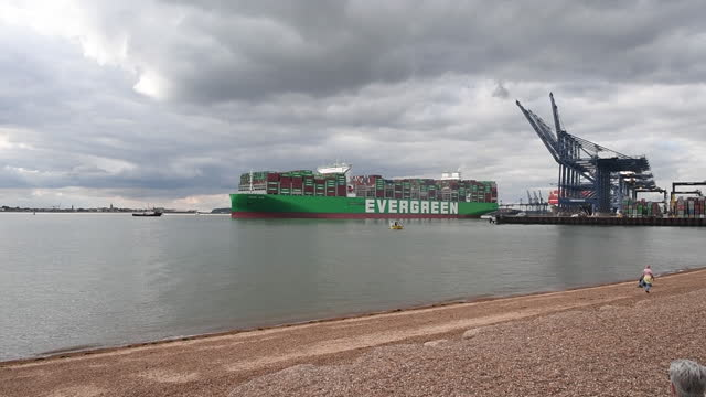 people at beach and world's largest container ship, ever ace, leaving port of felixstowe, in felixstowe, suffolk, england, u.k., on wednesday,... - western script stock videos & royalty-free footage