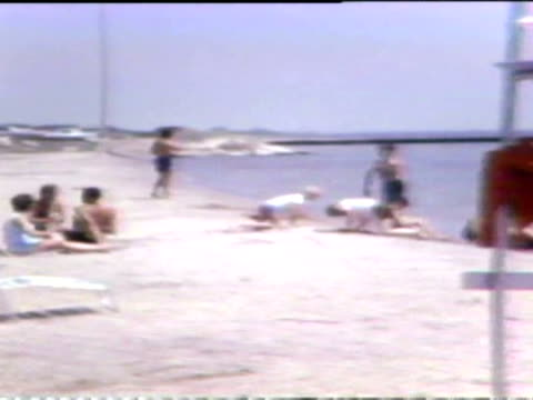 people at beach in 1971 on july 06 1971 in chicago illinois - seeufer stock-videos und b-roll-filmmaterial