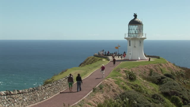 ws ha people at cape reinga lighthouse / north island, new zealand - north island new zealand stock videos & royalty-free footage