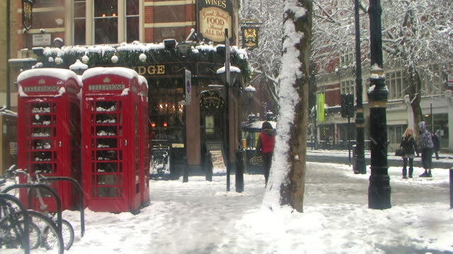 ms people at charing cross road covered with snow, london, united kingdom - snow stock videos & royalty-free footage