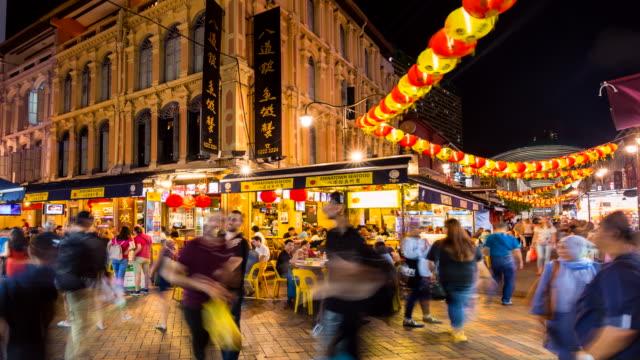 vídeos de stock, filmes e b-roll de tl ms people at chinatown market at night - mercado noturno