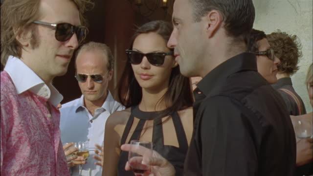 CU, People at cocktail party outdoors, Chateau du Parc, Saint Ferme, France