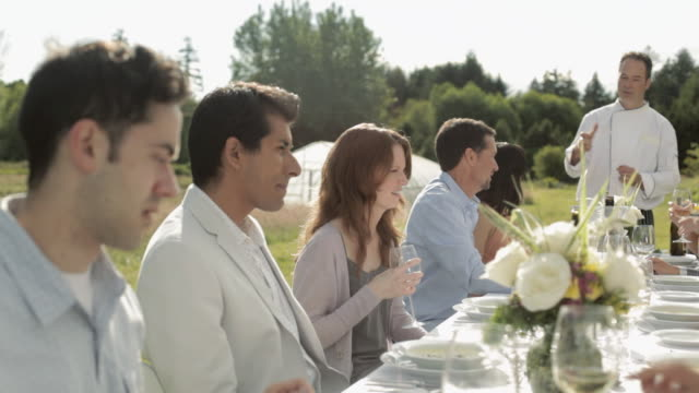 people at dinner party on a farm - dinnerparty stock-videos und b-roll-filmmaterial