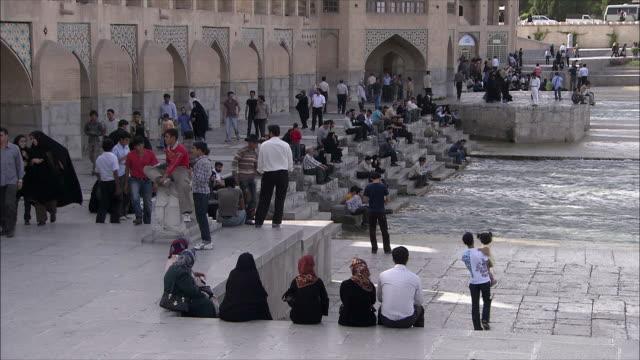 WS People at Khaju Bridge on Zayandeh River, Isfahan, Iran