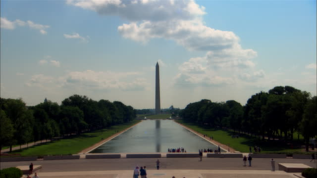 ws, zi people at mall pool and washington monument, washington dc, usa - washington monument washington dc stock videos & royalty-free footage