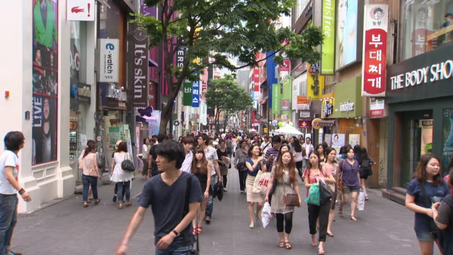 people at myeongdong shopping district - western script stock videos & royalty-free footage
