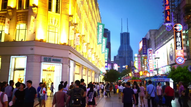 people at nanjing road, this area is the biggest shopping district in shanghai - nanjing stock videos & royalty-free footage
