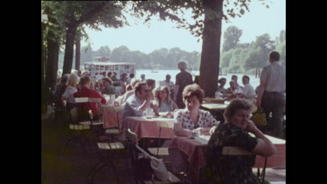 people at outdoor cafe tables beside east german lake; 1970 - germany stock videos & royalty-free footage