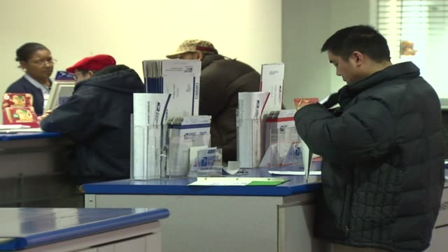 people at post office counter on december 22, 2009 in chicago, illinois - postamt stock-videos und b-roll-filmmaterial