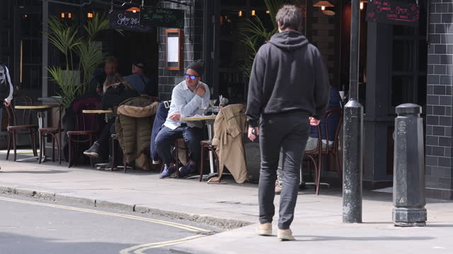 people at reopened restaurants in chinatown, london, uk, on monday, may 17, 2021. - new normal concept stock videos & royalty-free footage