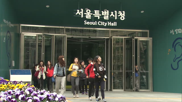 people at seoul city hall building - town hall stock videos & royalty-free footage