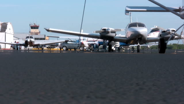 People at Small Airport - Ground View