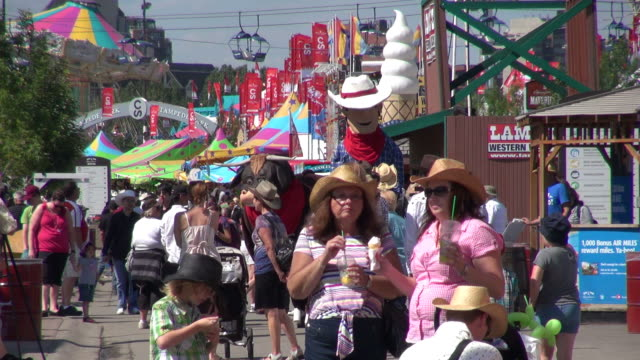 ms people at stampede park / calgary, alberta, canada  - fairground stall stock videos & royalty-free footage