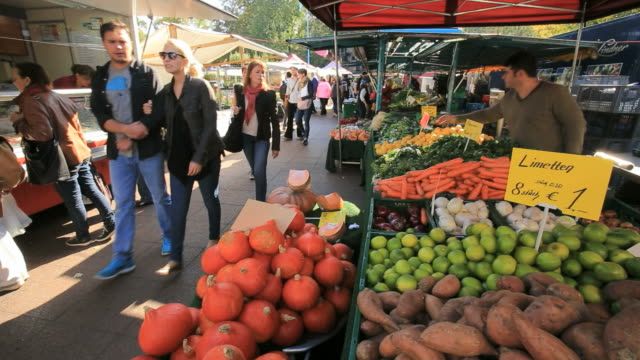 People at Sunday Food Market in Berlin, with Vegetable stalls