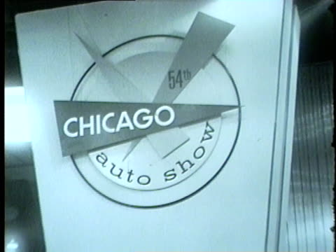 people at the 54th chicago auto show at mccormick place in 1962 - anno 1962 video stock e b–roll