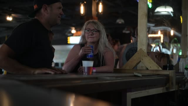 people at the big engine bar at the buffalo chip during the 80th annual sturgis motorcycle rally in sturgis, south dakota on august 9, 2020. while... - south dakota stock videos & royalty-free footage