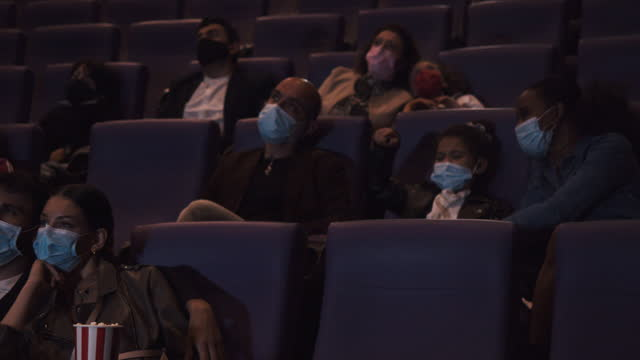 people at the movie theater watching a movie - film premiere stock videos & royalty-free footage