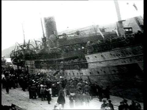 1918 montage b/w ws pan people at the port of yalta during the arrival of troops from the white army on board the saratov ship/ ms pan large crowd on board moored ship/ yalta, crimea, ukraine - 1918 stock videos & royalty-free footage