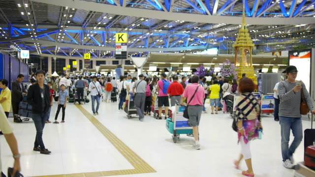 People at the Suvarnabhumi Airport, Bangkok International Airport, Thailand.
