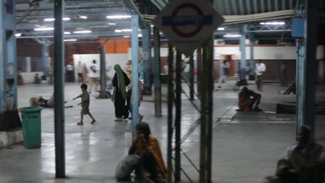 pov ws people at train station at night / india - focus on background stock videos and b-roll footage