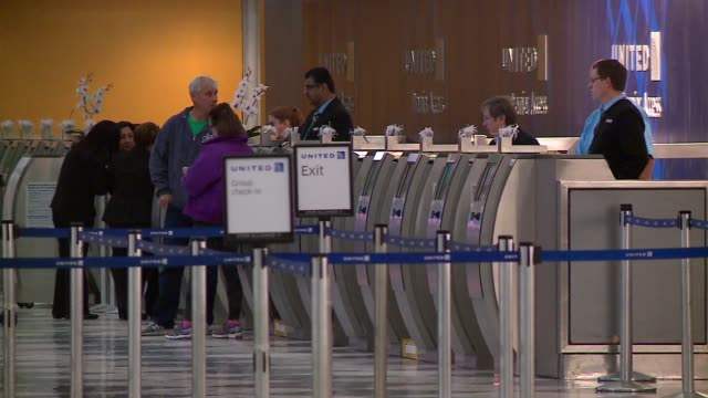 people at united airlines check-in counter at o'hare airport in chicago on november 23, 2015. - airport check in counter stock videos & royalty-free footage