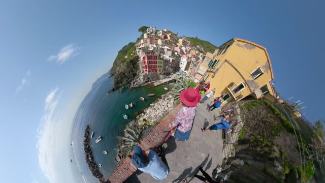 ZO / People at viewpoint of italian village with Little Planet Effect