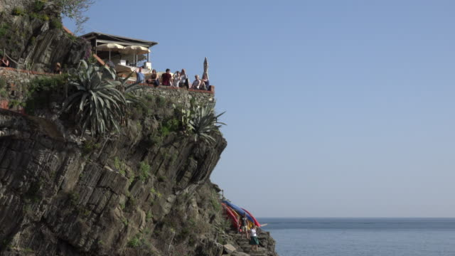People at viewpoint over the mediterranean sea