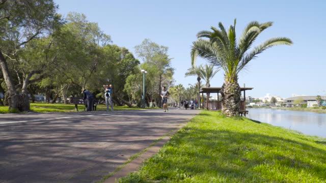 tel aviv: people at yarkon park in a sunny day in tel aviv. - tel aviv stock videos & royalty-free footage