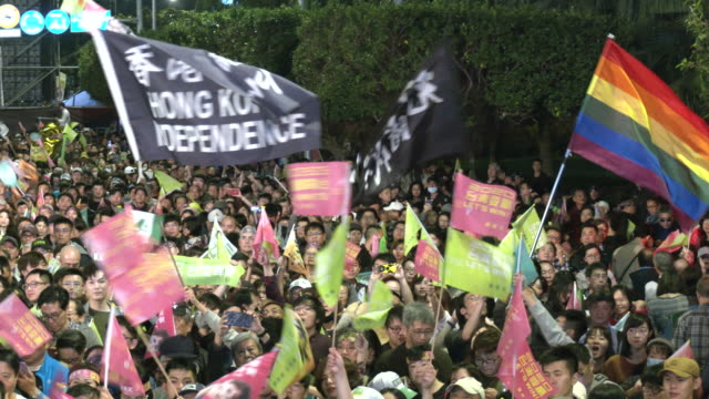 people attend a an democratic progressive party rally before the election of president tsai ing-wen, who won with a record 8 million votes and a... - hong kong flag stock videos & royalty-free footage