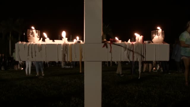 people attend a candlelight memorial service for the victims of the shooting at marjory stoneman douglas high school that killed 17 people on... - florida usa stock-videos und b-roll-filmmaterial
