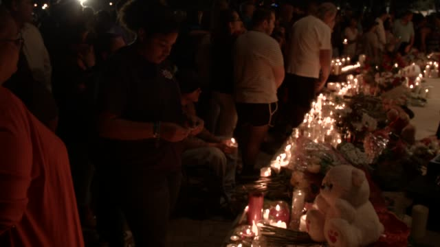 people attend a candlelight memorial service for the victims of the shooting at marjory stoneman douglas high school that killed 17 people on... - 追悼式点の映像素材/bロール