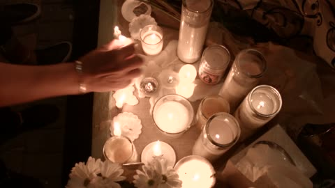 people attend a candlelight memorial service for the victims of the shooting at marjory stoneman douglas high school that killed 17 people on... - memorial video stock e b–roll