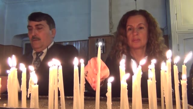 people attend a christmas eve mass led by priest dimirti yildirim at an orthodox church in iskenderun district of hatay turkey on december 24 2016 - hatay stock videos & royalty-free footage