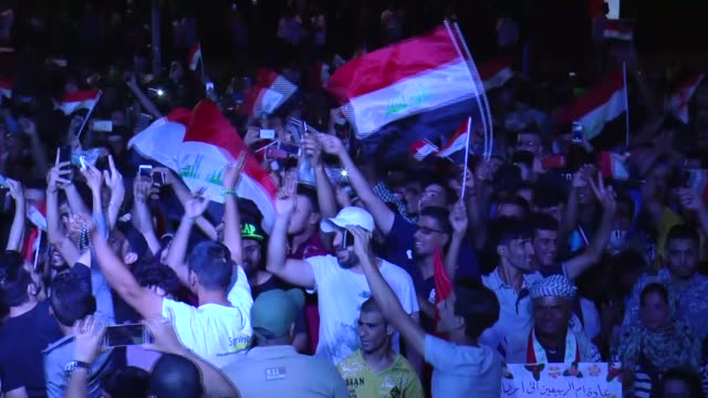 people attend a concert as they celebrate after mosul completely freed from daesh at altahrir square in baghdad iraq on july 11 2017 mosul was... - mosul stock videos and b-roll footage