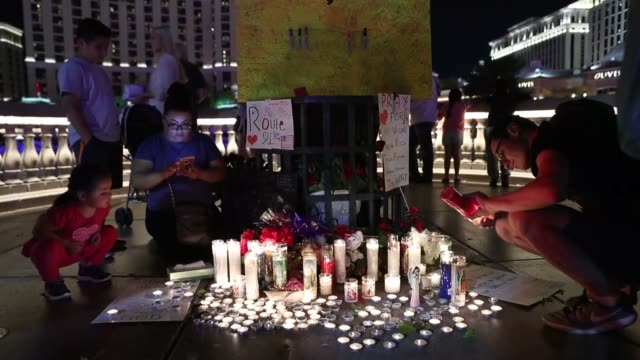 people attend a prayer vigil at mountain crest park for the victims of sunday night's shooting on october 03 2017 in las vegas nevada las vegas city... - mandalay bay resort and casino stock videos & royalty-free footage
