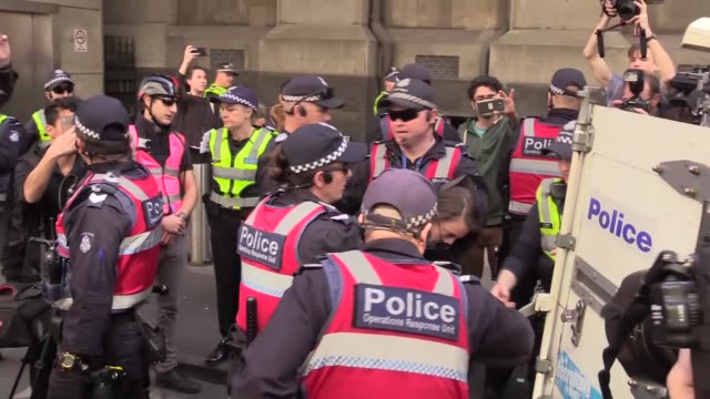 people attend a protest organized by leftwing group campaign against racism and fascism to counter rightwing groups 'make victoria safe again' protest - racism stock videos & royalty-free footage