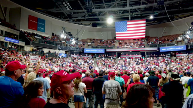 people attend a rally for president donald trump on august 15 2019 in manchester new hampshire - political rally stock videos & royalty-free footage