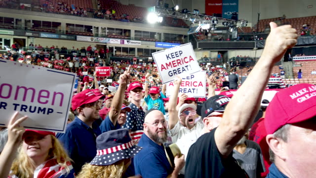 people attend a rally for president donald trump on august 15 2019 in manchester new hampshire - banner sign stock videos & royalty-free footage