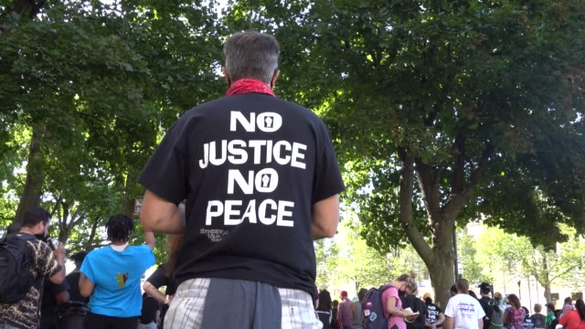 people attend a rally in support of jacob blake and his family in front of the kenosha county courthouse on august 29 2020 in kenosha wisconsin blake... - back to front stock videos & royalty-free footage