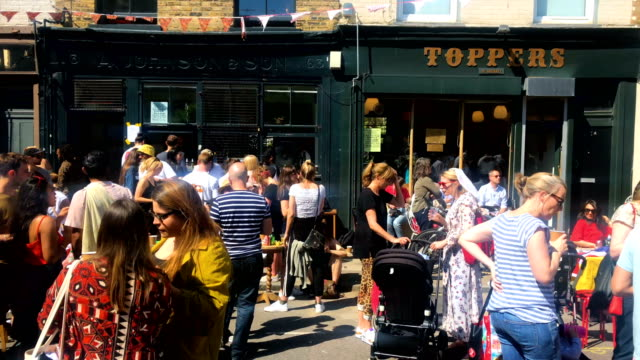 people attend a royal wedding street party to celebrate the marriage of prince harry and meghan markle at the wilton way hackney street party on may... - street party stock videos and b-roll footage
