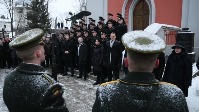 People attend a state ceremony at Rasos Cemetery during the 100th anniversary of the restoration of Lithuanian statehood on February 16 2018 in...