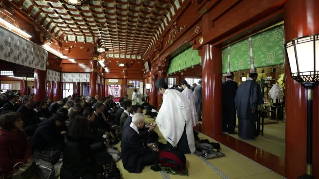 people attend a traditional ceremony to mark the first business day of the year at the kanda myojin shrine in tokyo japan on thursday jan 4... - shitamachi stock videos and b-roll footage