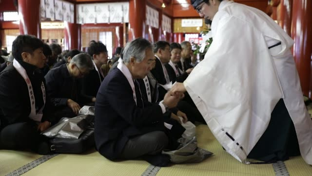 people attend a traditional ceremony to mark the first business day of the year at the kanda myojin shrine in tokyo, japan, on thursday, jan. 4... - ceremony stock videos & royalty-free footage