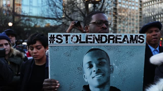 people attend a vigil for stephon clark, the young black man killed by police last month in sacramento, on the anniversary of the assassination of... - memorial vigil stock videos & royalty-free footage