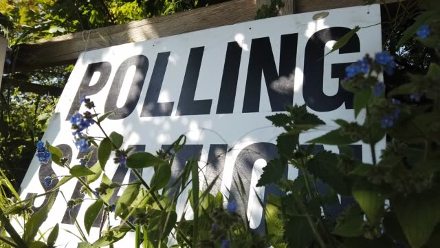 people attend at the prime minitser theresa may's local constituency polling station to vote in the european elections on may 23 2019 in sonning... - wahllokal stock-videos und b-roll-filmmaterial